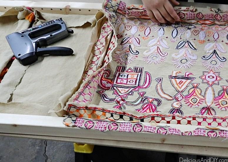staple gun the fabric onto the ikea ivar headboard