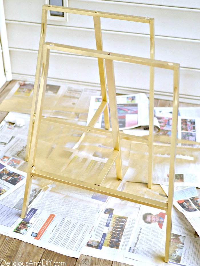 ikea table legs being spray painted gold