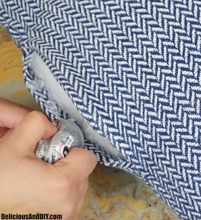 applying glue to seal the throw pillow