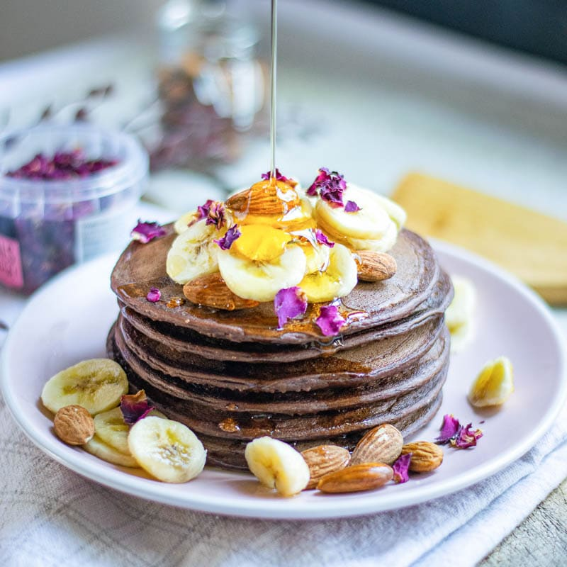 vegan pancakes with syrup pouring over