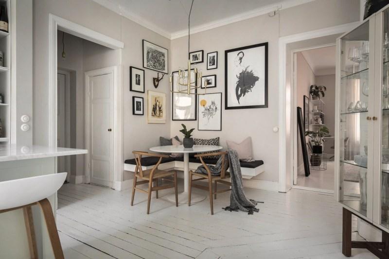 sillas CH24 wishbone de Carl Hansen mesa Saarinen de Knol estilo escandinavo cocinas decoración comedores nórdicos cocina nórdica cocina moderna cocina abierta banco en la pared