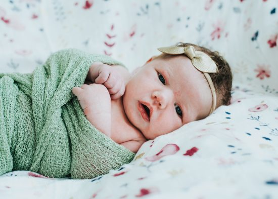 Newborn photography girl at home lifestyle