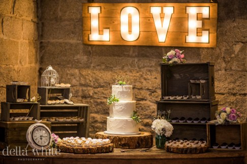 rustic cake and dessert table stone house