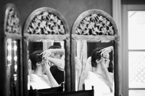 bride getting ready in multiple mirrors