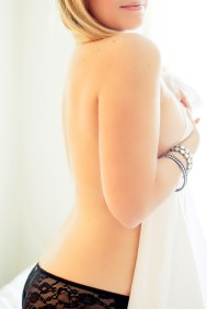 soft boudoir photo with sheer fabric