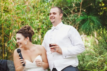 bride and groom giving a toast