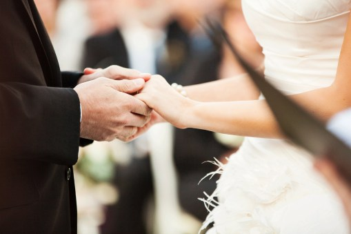 holding hands during the wedding vows