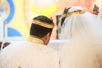 bride and groom crowned