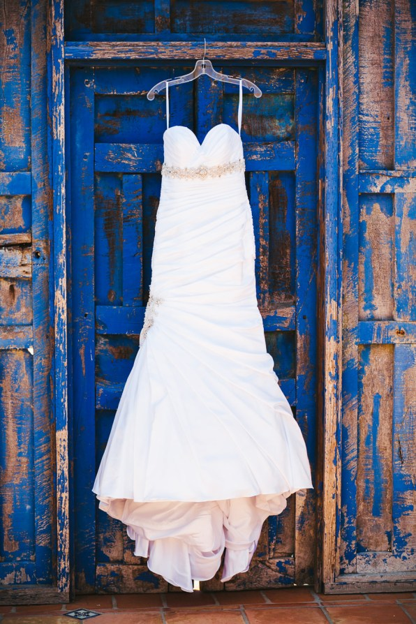 wedding dress on an old blue door