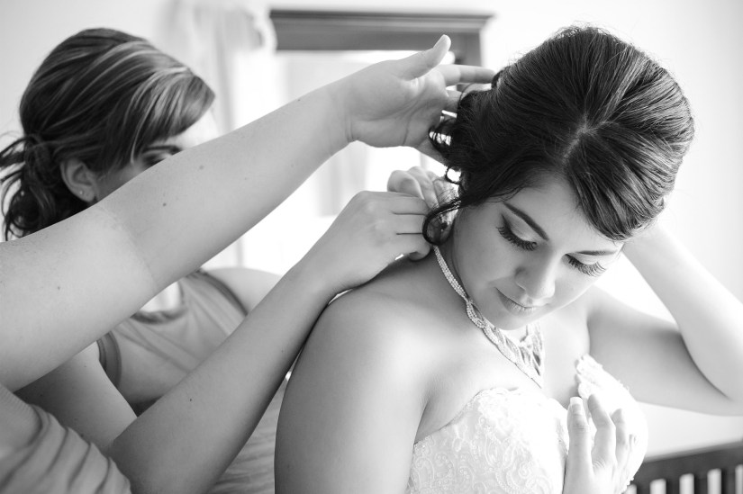 putting on the brides necklace