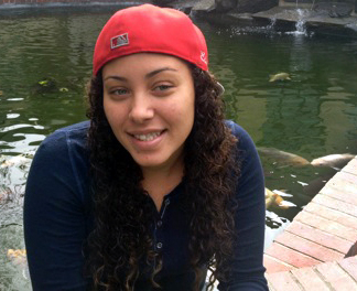 THE VOICE: Erica Lutrell at the campus Koi pond. PHOTO BY JERMAINE DAVIS