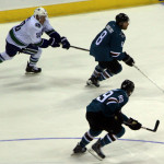 SHARK ATTACK: The San Jose Sharks get a breakaway early in second period action versus Vancouver. PHOTO BY RICHARD REYES