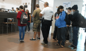 NOT ENOUGH MICROWAVES: As students warm up their food, a long line develops. PHOTO BY ORLANDO JOSE