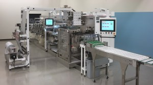 Medical converting and packaging machine
