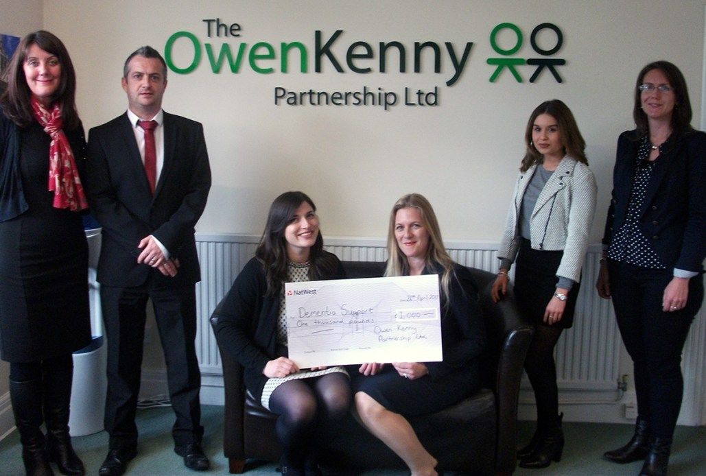 A photo of a presentation cheque to Dementia Support from Owen-Kenny Solicitors