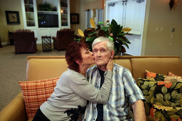 Gail Lansbury gives her husband Bruce Lansbury a kiss during one of her four weekly visits to Caleo Bay Alzheimer's Care Center in La Quinta where Bruce now lives. Photo taken on Tuesday, February 2, 2016.