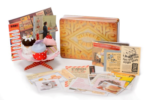 Custard Cream Storage with Memorabilia and Conversation Prompts from www.dementiaworkshop.co.uk