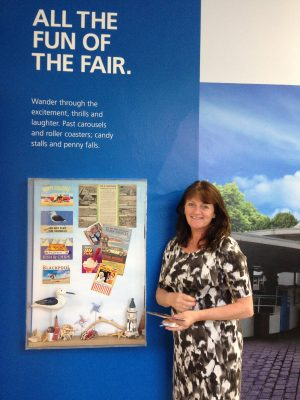 Gillian Hesketh of Happy Days Dementia Workshop puts the finishing touches to the 'Seaside' display cabinet
