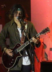 Above: Gunk guitarist