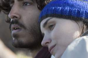 Dev Patel plays Saroo, a young man who yearns for his former family