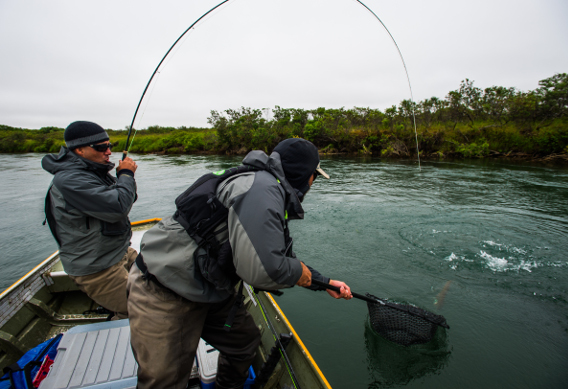 Fly fishing for trout from a boat.