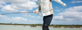 Setting the hook on a bonefish by Bill Kalm