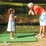 Denise coaching young golfer