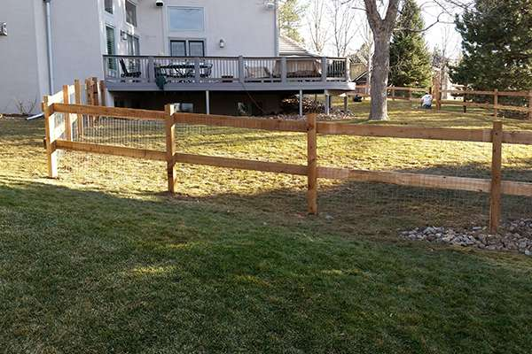 wood fence and grass A Straight Up Fence Company Denver