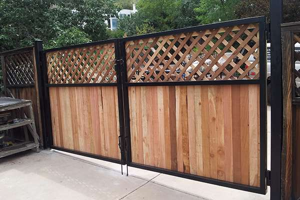 black metal and wood gate A Straight Up Fence Company Denver