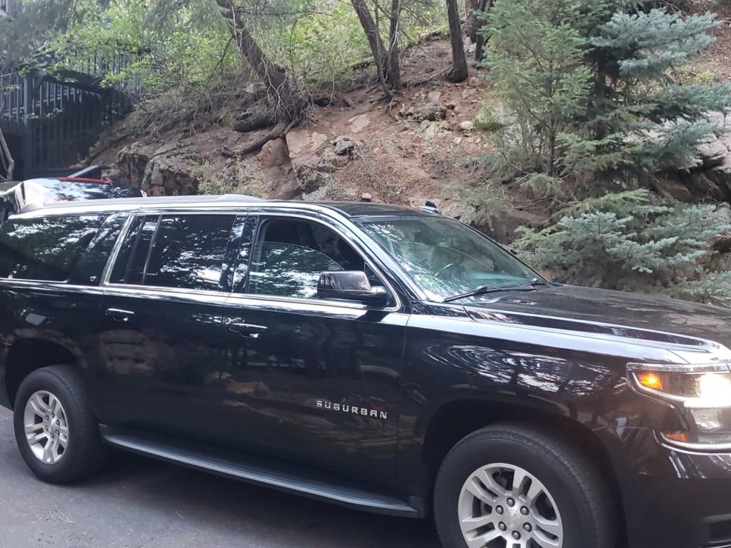 black luxury SUV at Evergreen CO