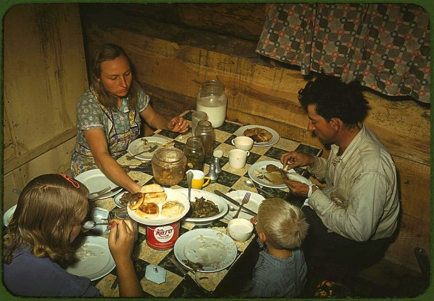 The Faro Caudill family eating dinner in their dugout. Pie Town, New Mexico, October 1940. Reproduction from color slide. Prints and Photographs Division, Library of Congress
