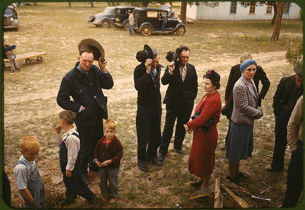 Saying grace before the barbecue dinner at the New Mexico Fair. Pie Town, New Mexico, October 1940. Reproduction from color slide. Prints and Photographs Division, Library of Congress
