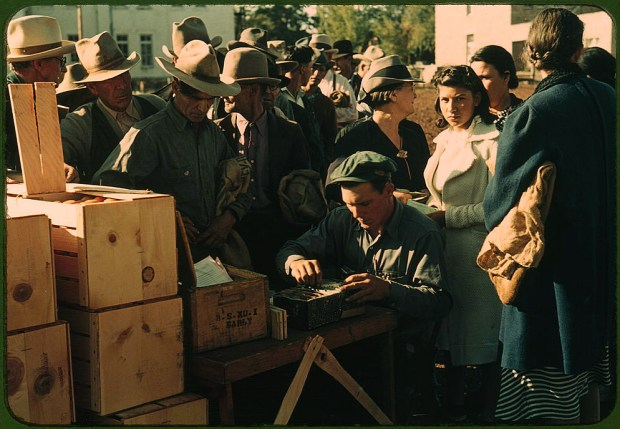 Distributing surplus commodities. St. Johns, Arizona, October 1940. Reproduction from color slide. Prints and Photographs Division, Library of Congress