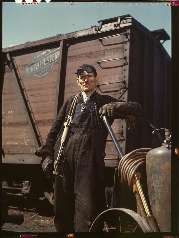 Mike Evans, a welder, at the rip tracks at Proviso yard of the Chicago and Northwest Railway Company. Chicago, Illinois, April 1943. Reproduction from color slide. Prints and Photographs Division, Library of Congress