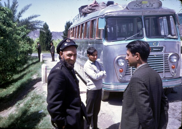 """""""In the spring of 1968, my family took a public, long-distance, Afghan bus through the Khyber Pass to visit Pakistan (Peshawar and Lahore). The road was rather bumpy in that direction, too. As I recall, it was somewhat harrowing at certain points with a steep drop off on one side and a mountain straight up on the other! I remember that, before we left Kabul, my father paid for a young man to go around the bus with a smoking censor to bless the bus or ward off the evil eye. I guess it worked - we had a safe trip."""" - Peg Podlich."""