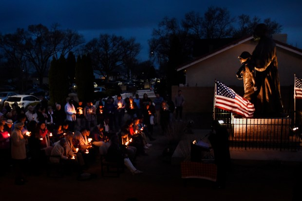 Heather Poole and her youngest son Tyler Clark take part in a candle light vigil at the Martin Luther King Jr. Cultural Center March 4, 2016 in Pueblo. Childhood friends and those that had come to love Heather's oldest son Devin Clark came to share their sorrow and show support for the family after Devin was the victim of a fatal drive by shooting while waiting outside of the Iron Horse Bar in downtown Pueblo.