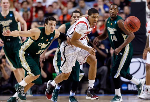 LEXINGTON, KY - MARCH 23: Dorian Green #22 of the Colorado State Rams and Wayne Blackshear #20 of the Louisville Cardinals go for a loose ball in the second half during the third round of the 2013 NCAA Men's Basketball Tournament at Rupp Arena on March 23, 2013 in Lexington, Kentucky.