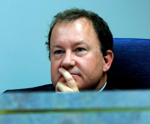 Douglas County school board member Doug Benevento listens to public input on school vouchers in 2010.
