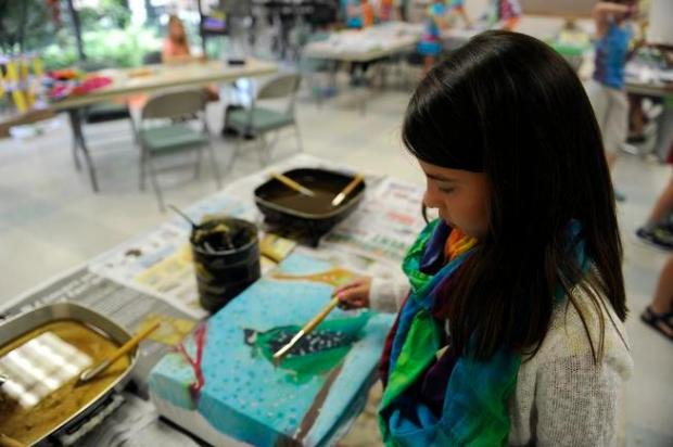 A girl takes part in a class at the Arvada Center in 2014. The center is a member of the Scientific and Cultural Facilities District.