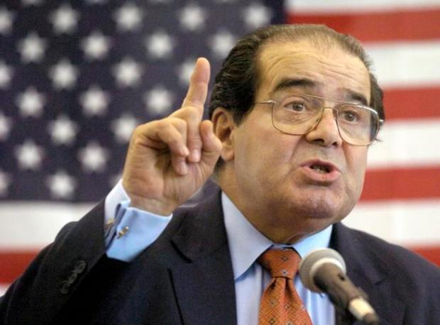 In this Wednesday, April 7, 2004 file photo, U.S. Supreme Court Justice Antonin Scalia speaks to Presbyterian Christian High School students in Hattiesburg, Miss. On Saturday, Feb. 13, 2016, the U.S. Marshall's Service confirmed that Scalia has died at the age of 79.