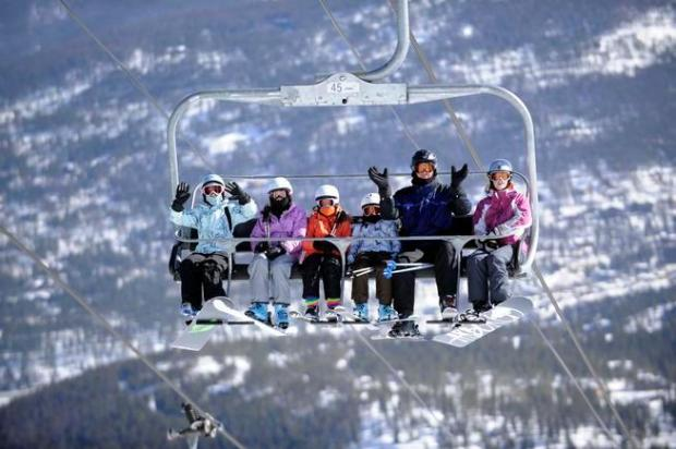 Skiers and snowboarders ride the Independence SuperChair at the Breckenridge ski area on Feb. 4, 2012.