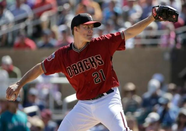 Arizona Diamondbacks' Zack Greinke (21) throws against the Seattle Mariners during the second inning of a spring training baseball game in Scottsdale, Ariz., Monday, March 14, 2016.