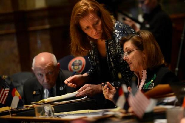 DENVER, CO. - MARCH 11: Majority Leader Morgan Carroll speaks with Gail Schwartz during testimony on HB13-1224 as the Denver Senate prepares for the 3rd reading concerning prohibiting large-capacity ammunition magazines at the Denver State Capitol March 11, 2013 Denver, Colorado. (Photo By Joe Amon/The Denver Post)