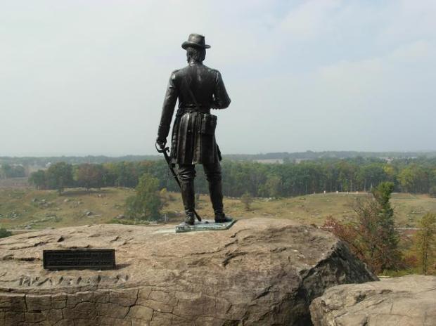 A statue of Brig. Gen. Gouverneur K. Warren overlooks the Gettysburg battlefield.