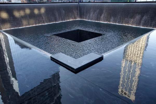 Water flows in a 9/11 Memorial pool during the 10th-anniversary ceremonies of the Sept. 11, 2001, terrorist attacks at the World Trade Center site in New York. Getty Images file
