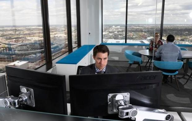 The commercial real estate firm CBRE opened it's new Workplace360 office for it's downtown Denver office in 2016. It is a global initiative to enhance their office spaces for creativity for CBRE. Fred Noblett a senior director in project management works at his desk in the office, at 1225 17th Street, on Wednesday, April 27, 2016.