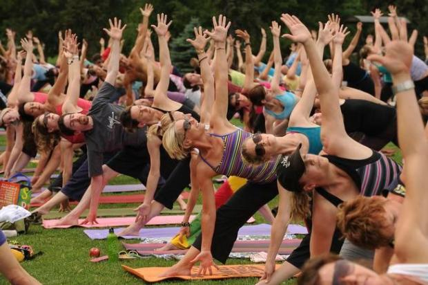 Nearly 300 people participate in a yoga class at Denver's City Park earlier this year. Colorado remained the leanest state in the nation in 2015, according to new data released earlier this month by the federal Centers for Disease Control and Prevention.