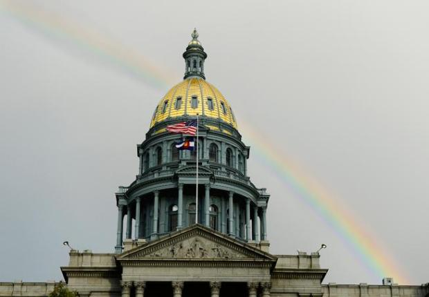 A rainbow appears after a brief rain Oct. 18, 2015 at the Colorado State Capitol Building.
