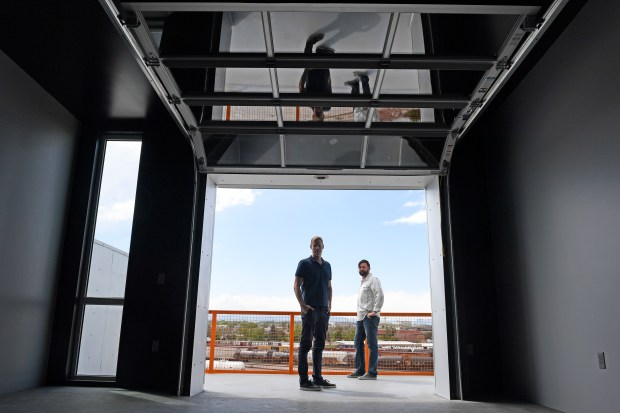 Kyle Zeppelin, left, owner of Zeppelin Development and Ben Holley, right, construction manager, are pictured inside one of the new apartment units available at their Freight Apartments in the Taxi development May 23, 2016. The mixed retail, residential and office site will now expand by 5.5 acres with the acquisition of the Ready Mix Concrete plant just to the north.