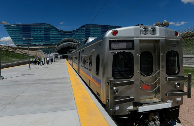 A new train leaves the new platforms of the FasTracks train station at Denver International Airport on April 12 in Denver. This University of Colorado A Line became available to the public on April 22.